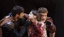 TITUS ANDRONICUS   by Shakespeare   design: William Dudley   director / Master of Play': Lucy Bailey l-r: Dyfan Dwyfor (Lucius), Flora Spencer-Longhurst (Lavinia), William Houston (Titus Andronicus)Sh...