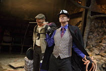 WAITING FOR GODOT   by Beckett   set design: Patrick Kinmonth   costumes: Annina von Pfuel   lighting: Peter Lundin   director: Simon Dormandy ~l-r: Michael Roberts (Lucky), Jonathan Oliver (Pozzo)~Ar...