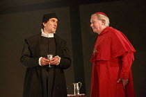 WOLF HALL   by Hilary Mantel   adapted by Mike Poulton   design: Christopher Oram   lighting: Paule Constable   director: Jeremy Herrin   l-r: Ben Miles (Thomas Cromwell), Paul Jesson (Cardinal Wols...