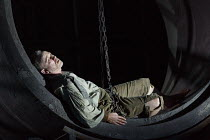 FIDELIO   by Beethoven   conductor: Douglas Boyd   design: Gary McCann   lighting: Howard Hudson   director: John Cox   awakening in his cell: Peter Wedd (Florestan) Garsington Opera at Wormsley / O...