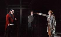 FIDELIO   by Beethoven   conductor: Douglas Boyd   design: Gary McCann   lighting: Howard Hudson   director: John Cox   Fidelio challenges Don Pizarro - l-r: Darren Jeffery (Don Pizarro), Stephen Ric...