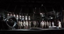 FIDELIO   by Beethoven   conductor: Douglas Boyd   design: Gary McCann   lighting: Howard Hudson   director: John Cox   prisoners with (far right) Sam Furness (Jaquino), Jennifer France (Marzelline)...