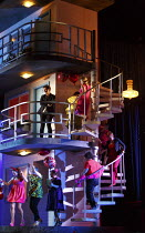 MANON LESCAUT   by Puccini   conductor: Antonio Pappano   design: Paul Brown   lighting: Mark Henderson   director: Jonathan Kent   opening scene, partygoers, with (on first landing) Jonas Kaufmann (...