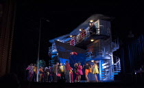 MANON LESCAUT   by Puccini   conductor: Antonio Pappano   design: Paul Brown   lighting: Mark Henderson   director: Jonathan Kent   stage,set,appartments,crowd,partygoers The Royal Opera (RO) / Cove...