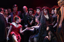 LA TRAVIATA   by Verdi   conductor: Mark Elder   design: Hildegard Bechtler   lighting: Peter Mumford   director: Tom Cairns   front left: Hanna Hipp (Flora Bervoix)   centre: Mandy Dassa (gypsy fort...