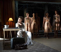 MEDEA   by Euripides   in a new version by Ben Power   design: Tom Scutt   lighting: Lucy Carter   director: Carrie Cracknell~~Helen McCrory (Medea) and Chorus~Olivier Theatre / National Theatre (NT),...