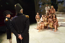 PITCAIRN   by Richard Bean   design: Tim Shortall   lighting: Johanna Town   director: Max Stafford-Clark ~Christian (seated centre, with hat) opts to stay behind: Tom Morley (Fletcher Christian)   wi...
