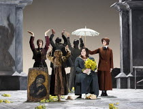 OTELLO   by Verdi   after Shakespeare   conductor: Edward Gardner   design: Jon Morrell   lighting: Adam Silverman   director: David Alden ~(seated) Leah Crocetto (Desdemona), (holding umbrella) Pamel...