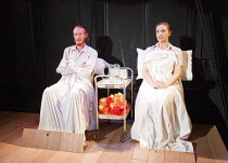 FRED AND MADGE   by Joe Orton   design: Christopher Hone   lighting: Seth Rook Williams   director: Mary Franklin ~in hospital: Jake Curran (Fred), Jodyanne Richardson (Madge) ~Hope Theatre, Hope & An...