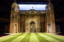 LOVE'S LABOUR'S LOST   by Shakespeare   design: Simon Higlett   lighting: Oliver Fenwick   director: Christopher Luscombe ~stage,set,full,empty,exterior,Charlecote,Park,Tudor,brickwork,sundial,flag,la...
