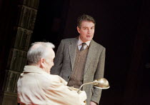 ACCOLADE   by Emlyn Williams   design: James Cotterill   lighting: Peter Mumford   director: Blanche McIntyre   Trenting confronts his accuser - l-r: Bruce Alexander (Daker), Alexander Hanson (Will Tr...