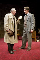 ACCOLADE   by Emlyn Williams   design: James Cotterill   lighting: Peter Mumford   director: Blanche McIntyre   Daker with the incriminating photos - l-r: Bruce Alexander (Daker), Alexander Hanson (Wi...