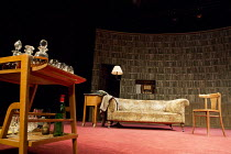 ACCOLADE   by Emlyn Williams   design: James Cotterill   lighting: Peter Mumford   director: Blanche McIntyre   stage,set,empty,settee,books,library,radio,1950s, drinks,alcolhol,decanter,wine,bottle S...
