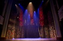 MERLIN   by Ella Hickson   design: Yannis Thavoris   lighting: Tim Lutkin   director: Liam Steel   stage,full,set,empty,library,books,banners,trees,lights Theatre Royal / Royal & Derngate, Northampton...