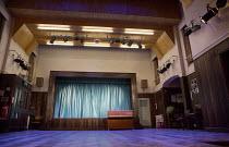 HOPE   by Jack Thorne   design: Tom Scutt   lighting: Chahine Yavroyan   director: John Tiffany   stage,set,empty,hall,interior,curtains,platform,piano,lights Jerwood Theatre Downstairs / Royal Court...