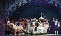 CINDERELLA   written by Eric Potts   choreographer: Lizzi Gee   director: Ian Talbot in the sleigh: Amy Lennox (Cinderella)   far right: Tim Vine (Buttons),New Wimbledon Theatre, London SW19  f09/12/2...