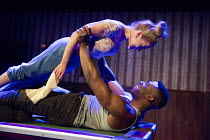 OTHELLO   by Shakespeare   design: Laura Hopkins   lighting: Natasha Chivers   director: Scott Graham Kirsty Oswald (Desdemona), Mark Ebulue (Othello) a Frantic Assembly & Theatre Royal Plymouth  co-p...