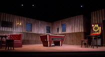 OTHELLO   by Shakespeare   design: Laura Hopkins   lighting: Natasha Chivers   director: Scott Graham stage,set,empty,bar,interior,juke box,billard,snooker,tablea Frantic Assembly & Theatre Royal Plym...