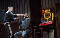 OTHELLO   by Shakespeare   design: Laura Hopkins   lighting: Natasha Chivers   director: Scott Graham plying with alcohol - l-r: Steven Miller (Iago), Ryan Fletcher (Cassio)a Frantic Assembly & Theatr...