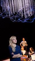 THE HARD PROBLEM   by Tom Stoppard   design: Bob Crowley   lighting: Mark Henderson   director: Nicholas Hytner front left: Olivia Vinall (Hilary)   rear, l-r: Lucy Robinson (Ursula), Parth Thakerer (...