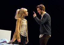 THE HARD PROBLEM   by Tom Stoppard   design: Bob Crowley   lighting: Mark Henderson   director: Nicholas Hytner Olivia Vinall (Hilary), Damien Molony (Spike)Dorfman Theatre / National Theatre (NT), Lo...