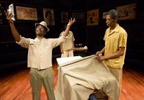 front, l-r: Victor Romero Evans (Frank), Johann Myers (Ramjohn Gookool) in PLAY MAS by Mustapha Matura at the Orange Tree Theatre, Richmond, Surrey, England  13/03/2015  design: Libby Watson   lighti...