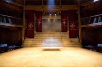 THE JEW OF MALTA   by Christopher Marlowe   design: Lily Arnold   lighting: Oliver Fenwick   director: Justin Audibert   stage,set,full,empty,balcony,auditorium,seats,lights,steps,banners Royal Shakes...