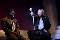 THE JEW OF MALTA   by Christopher Marlowe   design: Lily Arnold   lighting: Oliver Fenwick   director: Justin Audibert l-r: Lanre Malaolu (Ithamore), Jasper Britton (Barabas)Royal Shakespeare Company...