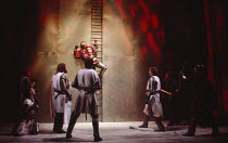 HENRY V   by Shakespeare   design: Bob Crowley   lighting: Robert Bryan   director: Adrian Noble    city wall of Harfleur - top centre: Kenneth Branagh (Henry V)Royal Shakespeare Company (RSC) / Royal...