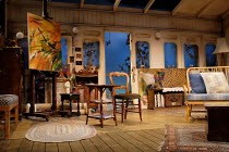 AFTER ELECTRA   by April de Angelis   design: Michael Taylor   lighting: Malcolm Rippeth   director: Samuel West stage,set,empty,railway,carriage,artist.studio,interior,paintingTricycle Theatre, Londo...