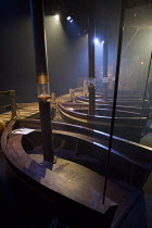 AGAINST CAPTAIN'S ORDERS: A JOURNEY INTO THE UNCHARTED   written by Simon Davies   design: Livi Vaughan   lighting: Euan Maybank   director: Peter Higgin set,empty,boats,sailing,ropes,lightsPunchdrunk...