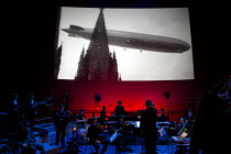 THREE TALES   by Steve Reich (music) & Beryl Korot (video design)   the Hindenberg zeppelin disaster  Ensemble BPM, iMax Theatre, The Science Museum, London SW7   22/04/2015  Donald Cooper/Photostage...
