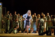 Justina Gringyte (Carmen) in CARMEN by Bizet at English National Opera (ENO), London Coliseum WC2  20/05/2015  conductor: Richard Armstrong  set design: Alfons Flores & Kieron Docherty  costumes: Mer...