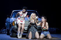 reading the cards - l-r: Rhian Lois (Frasquita), Justina Gringyte (Carmen), Clare Presland (Mercedes) in CARMEN by Bizet at English National Opera (ENO), London Coliseum WC2  20/05/2015  conductor: R...