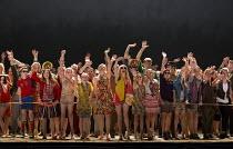 the crowd greet the toreadors: chorus & children in CARMEN by Bizet at English National Opera (ENO), London Coliseum WC2  20/05/2015  conductor: Richard Armstrong  set design: Alfons Flores & Kieron...