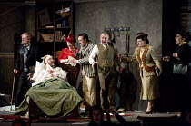 IL TRITTICO   by Puccini   GIANNI SCHICCHI   design: Neil Irish   lighting: Richard Howell   revival director: Oliver Platt   in bed (disguised as Buoso Donati) Richard Burkhard (Gianni Schicchi) with...
