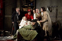 IL TRITTICO   by Puccini   GIANNI SCHICCHI   design: Neil Irish   lighting: Richard Howell   revival director: Oliver Platt   in bed (disguised as Buoso Donati) Richard Burkhard (Gianni Schicchi), (k...