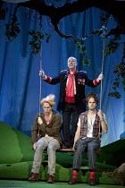 COSI FAN TUTTE   by Mozart   conductor: Douglas Boyd   design: Dick Bird   lighting: Bruno Poet   director: John Fulljames l-r: Robin Tritschler (Ferrando), Neal Davies (Don Alfonso), Ashley Riches (G...