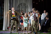 COSI FAN TUTTE   by Mozart   conductor: Douglas Boyd   design: Dick Bird   lighting: Bruno Poet   director: John Fulljames shock treatment - front, l-r: Robin Tritschler (Ferrando), Lesley Garrett (De...
