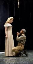 OTHELLO  by Shakespeare  set & lighting  design: Ciaran Bagnall  costumes: Fotini Dimou  director: Iqbal Khan ~begging forgiveness - Act 4 sc.2: Joanna Vanderham (Desdemona), Hugh Quarshie (Othello)~R...
