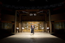 VOLPONE   by Ben Jonson   design: Stephen Brimson Lewis   lighting: Tim Mitchell   director: Trevor Nunn   Henry Goodman (Volpone)   showing full stage, stock exchange prices, gold bars  Royal Shake...