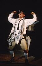 THE TRACKERS OF OXYRHYNCHUS   written & directed by Tony Harrison   design: Jocelyn Herbert   laktismography: Lawrence Evans   lighting: Paul McLeish   Jack Shepherd (B. P. Grenfell) Olivier Theatre /...