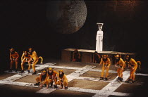 THE TRACKERS OF OXYRHYNCHUS   written & directed by Tony Harrison   design: Jocelyn Herbert   laktismography: Lawrence Evans   lighting: Paul McLeish   rear: Edna Dore (Kyllene) with chorus of Tracke...