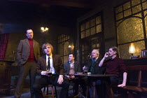 HANGMEN   by Martin McDonagh   design: Anna Fleischle   lighting: Joshua Carr   director: Matthew Dunster   left, standing: Ralph Ineson (Inspector Fry)   seated: Johnny Flynn (Mooney) Jerwood Theatre...
