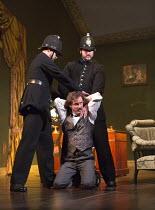 GASLIGHT   by Patrick Hamilton   design: William Dudley   lighting: Chris Davey   director: Lucy Bailey   under arrest: Jonathan Firth (Jack Manningham) Theatre Royal / Royal & Derngate, Northampton,...
