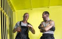 THE HAIRY APE   by Eugene O'Neill   design: Stewart Laing   lighting: Mimi Jordan Sherin   choreography: Aletta Collins   director: Richard Jones l-r: Steffan Rhodri (Paddy), Bertie Carvel (Yank) Old...