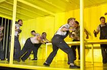 THE HAIRY APE   by Eugene O'Neill   design: Stewart Laing   lighting: Mimi Jordan Sherin   choreography: Aletta Collins   director: Richard Jones centre, pushing table: Bertie Carvel (Yank)   front ri...