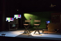 RoosevElvis   by the TEAM / Brooklyn,NY, USA   set design: Nick Vaughan   costumes: Kristen Sieh   lighting: Austin Smith   director: Rachel Chavkin stage,set,empty,chairs,microphone,studio,screens,mo...