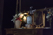 THE MODERATE SOPRANO   by David Hare   design: Rae Smith   lighting: James Farncombe   director: Jeremy Herrin ~~set,detail,dressing,table,mirror,flowers,vase,make-up brushes,family photographs ~Hamps...