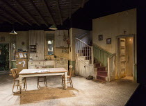 PIG FARM   by Greg Kotis   design: Carla Goodman   lighting: Jason Taylor   director: Katharine Farmer stage,set,empty,interior,house,American,USA,kitchen,stairs,doorsSt. James Theatre, London SW1   2...